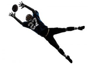 Football Player Dropping Ball