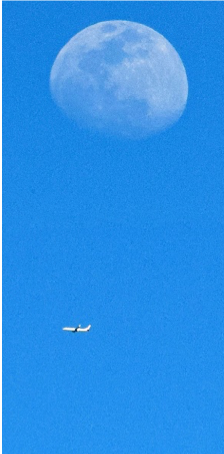Plane Passing Arizona Moon