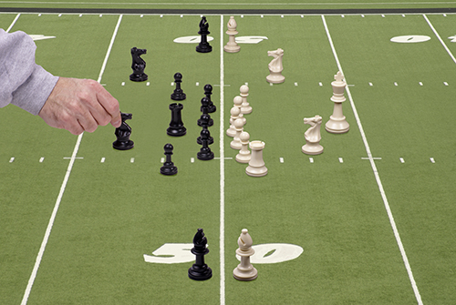 Chess Football with Defensive Coach - Should Investors Play Offense, Defense Or Both?