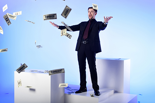 Man throwing money - MMT – Modern Monetary Theory –or– Magic Money Tree?