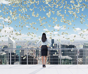 Rear view of the full length brunette woman who stands on the roof terrace in New York city. Falling dollar notes are falling down from the sky.