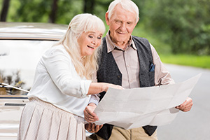 older couple reading map