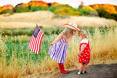 Smiling child celebrating 4th july - Independence Day