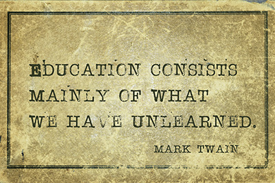 Education consists mainly of what we have unlearned - famous American writer Mark Twain quote printed on grunge vintage cardboard