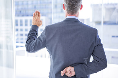 Businessman making a oath while crossing fingers behind his back - When You Get A Guarantee, Check The Hands Behind The Back!
