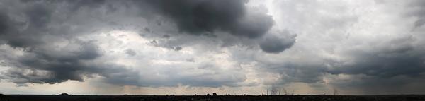 Dark rain clouds over the city, panorama