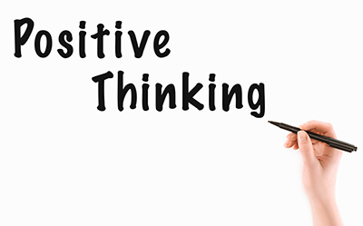 """Hand with marker writing """"positive thinking"""""""
